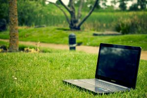 a laptop outdoors in the summer